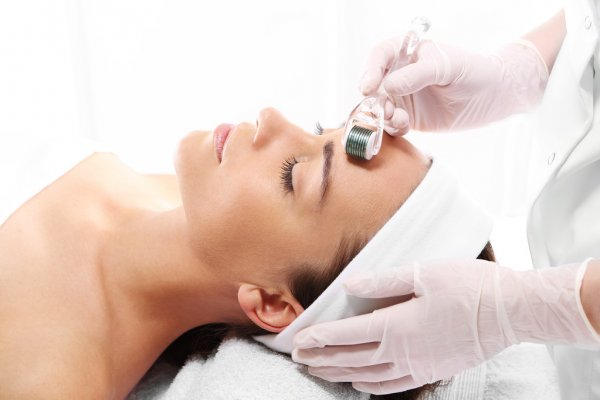 facial aesthetic treatment with derma roller